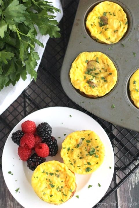 These gluten-free Mini Crustless Quiche Cups bake in just 15 minutes! A delicious, easy weekend brunch! Even better … they refrigerate and freeze beautifully, so they're a perfect make-ahead breakfast recipe for busy mornings, too! | www.TwoHealthyKitchens.com