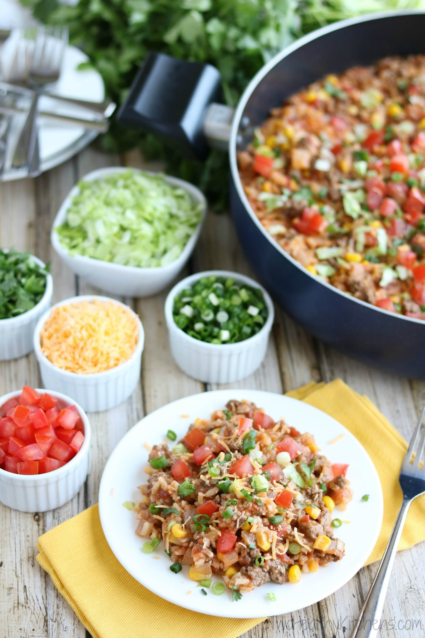 A fun, easy way to shake up the typical Taco night! This Mexican Rice Skillet Dinner is ready in just 30 minutes! Loaded with yummy Tex-Mex flavor, it's a quick, one-pot dinner recipe your whole family will love! | www.TwoHealthyKitchens.com
